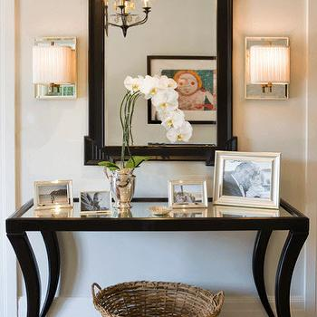 Gold mirrored console table with gold sunburst mirror Foyer console decorating ideas