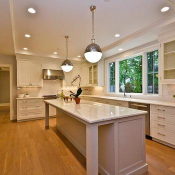 Long Kitchen Islands. White KItchen Cabinets with Stainless Steel Appliances