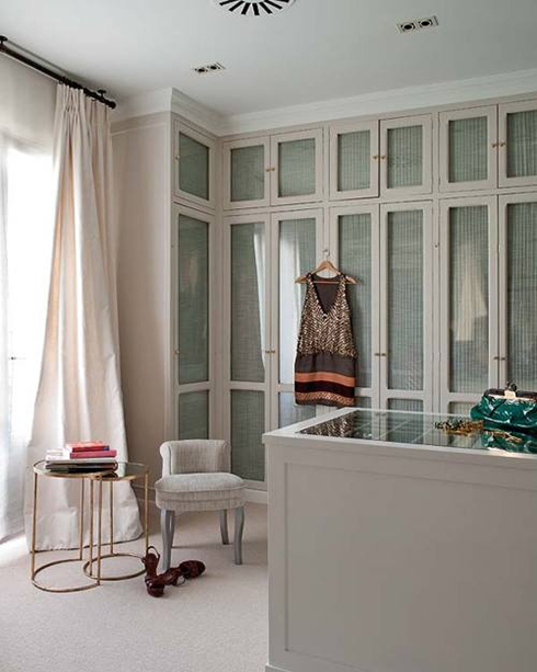 Soler Roig Eugenia   Gorgeous Walk In Closet Design With Floor To Ceiling  Built In Light Gray Cabinets With Glass Doors.