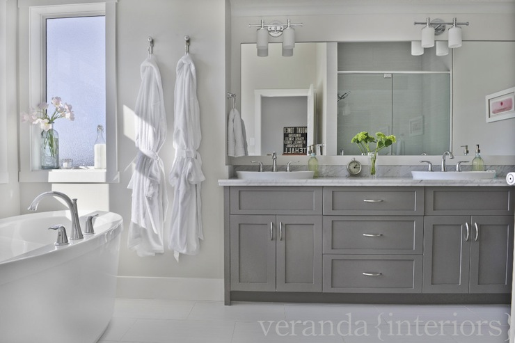 stunning ensuite gray bathroom with gray paint color and modern