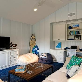 Kids Bedroom Tv family room and playroom with kids art on wall - transitional
