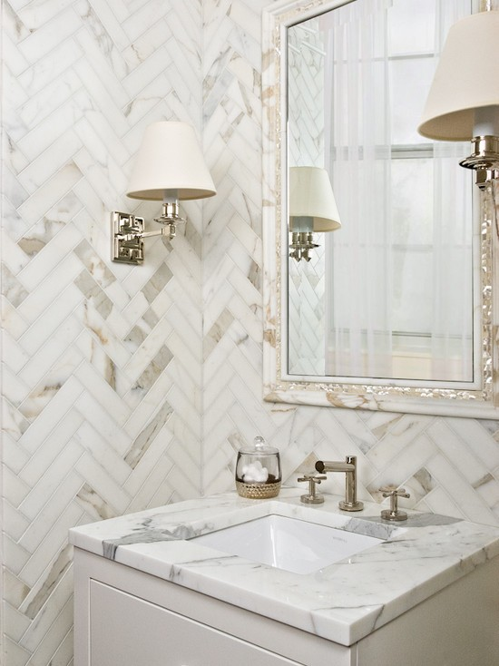 Amazing Bathroom With Calcutta Gold Marble Herringbone Tile Walls And