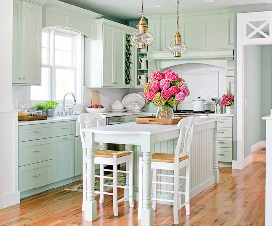 Fresh Country Style Kitchen With Light Hardwood Floors And Mint Green  Kitchen Cabinetry And Island.