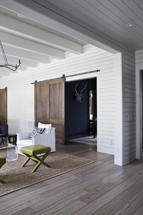 Sliding barn door eclectic living room heather a for Sliding barn door living room
