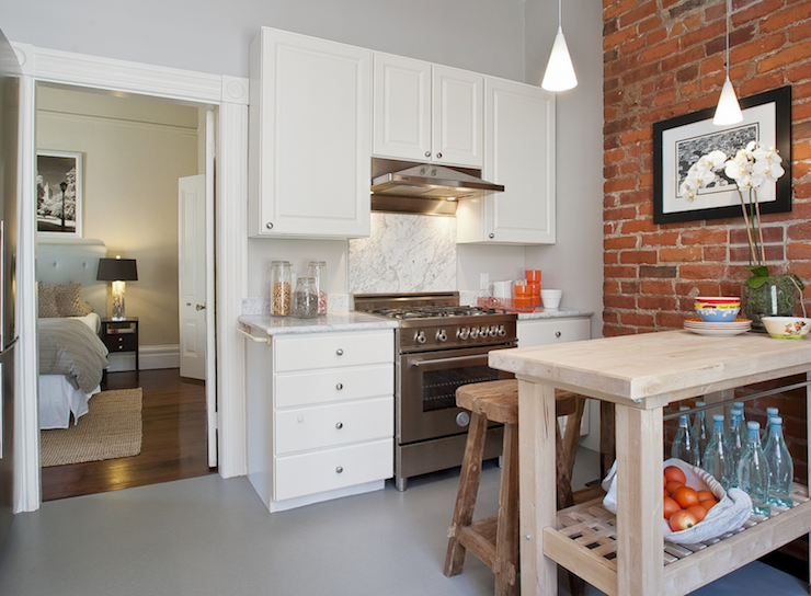 Exposed brick wall contemporary kitchen tamara mack for Kitchen bricks design