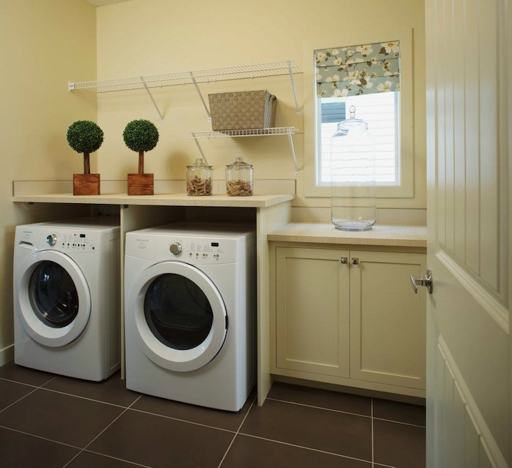 Charming Pale Yellow Laundry Room With Cream Shaker