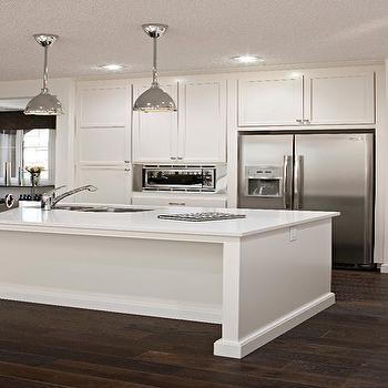 White kitchen cabinets modern kitchen cardel designs for Chocolate kitchen cabinets with stainless steel appliances