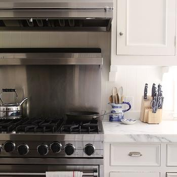 stainless steel cooktop backsplash