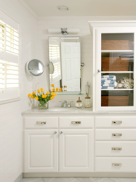 Glass front cabinets cottage bathroom tobi fairley - Bathroom vanities with storage towers ...