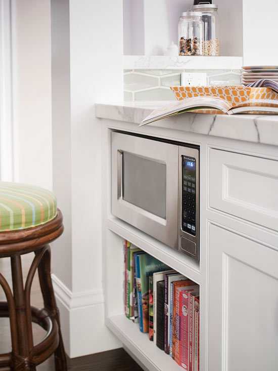 Countertop Microwave To Built In : White kitchen peninsula with built-in microwave nook and bookcase.
