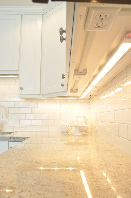 Merveilleux KItchen With Hidden Under Cabinet Outlets. Creamy White Shaker Kitchen  Cabinets With Granite Countertops And Subway Tile Backsplash.