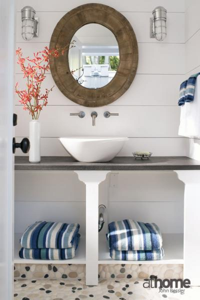 Wood tiled mirror with mirrored quatrefoil sconces for Quatrefoil bathroom decor