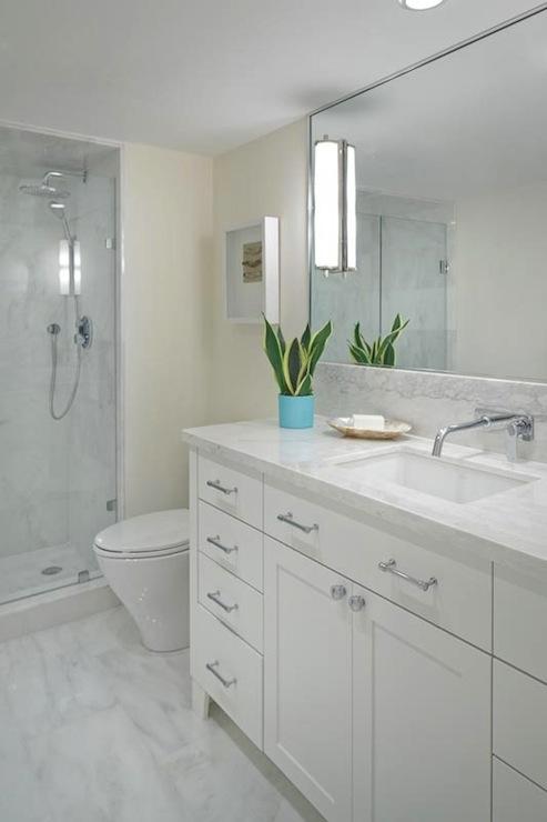 Contemporary Bathroom With Cream Bathroom Walls Paint Color And Marble  Bathroom Floor Tiles.