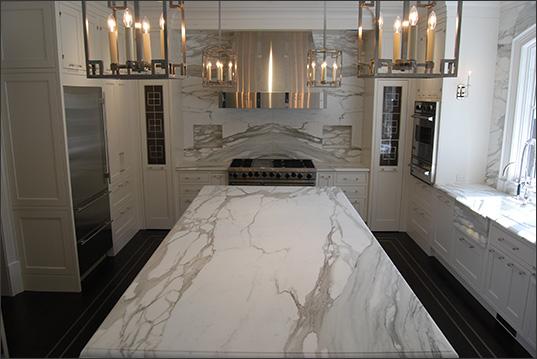 photos with calcutta gold marble kitchen island