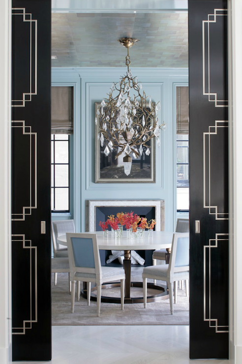Elegant tuquoise blue walls and dining chairs. Black Pocket Doors. Come find Beachy Turquoise Decor Inspiration to float your boat! #turquoise #decorinspiration #coolblue #diningroom