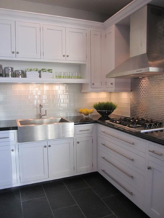 kitchen with white cabinets and stainless steel accents