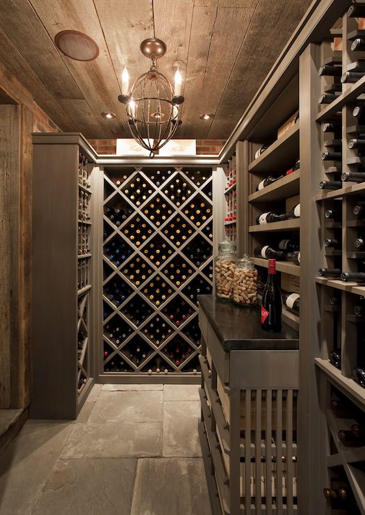 Basement Wine Cellar With Rustic Plank Ceiling And Stone