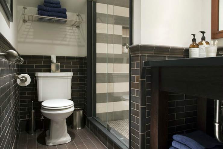 boyu0027s bathroom design with offwhite walls paired with gray and brown linear tiles and faux wood bathroom floor