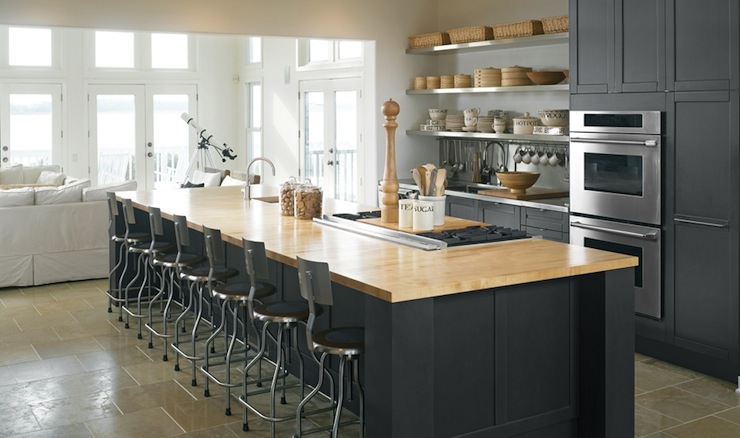 Charcoal gray kitchen cabinets paired with stainless steel perimeter