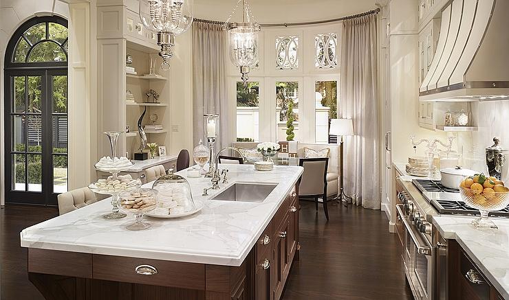 Glamorous Kitchen Design With Curved Banquette Filling Bay Window And Floor  To Ceiling Pinch Pleat Sheer Curtains.