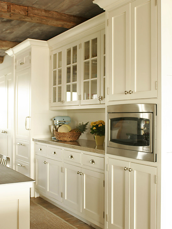 Cream kitchen cabinets country kitchen shelter for Country kitchen cabinets