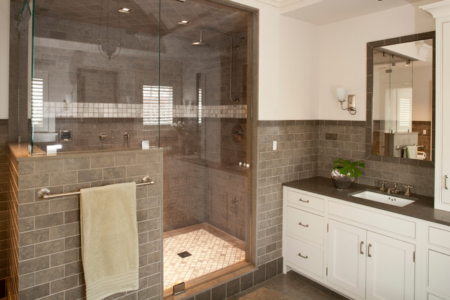 Lovely Bathroom With Seamless Glass Shower And Gray Subway Tile Surround