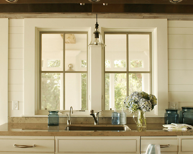 Farmhouse KItchen Cabinets Country Kitchen Shelter Interiors LLC - Light fixture over kitchen sink