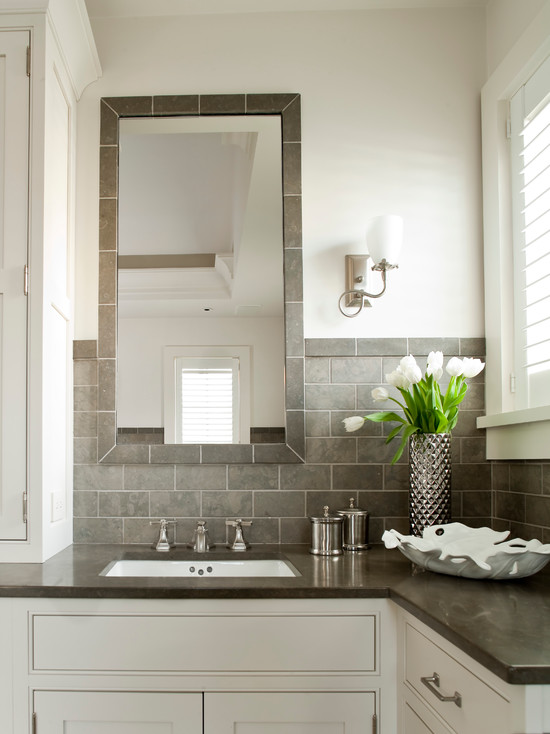 white and gray bathroom with white walls paired with gray subway tile
