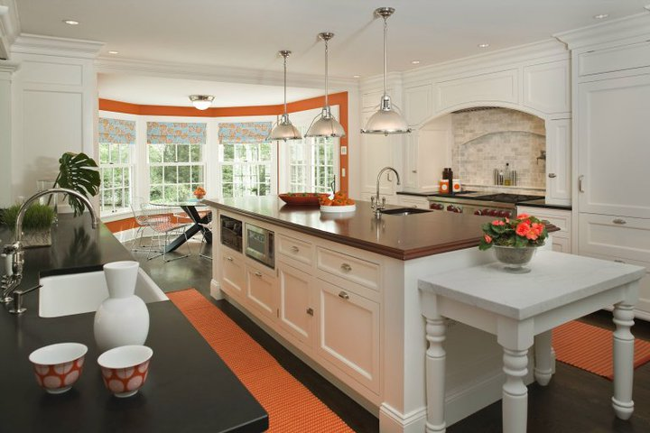 White Kitchen Orange Accents dark gray center island with waterfall quartz countertop