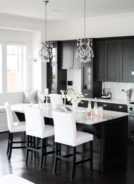 kitchen with a pair of beaded crystal chandeliers above large kitchen