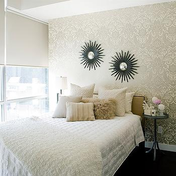 beautiful urban bedroom with gold damask wallpaper and dark hardwood