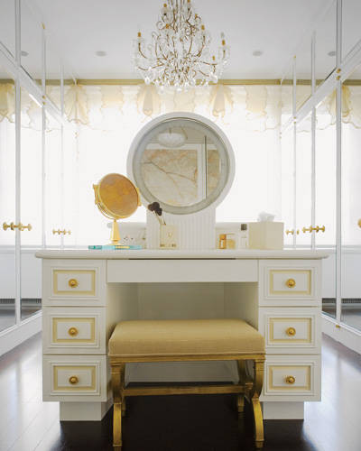 Glamorous Walk In Closet With Mirror Fronted Doors