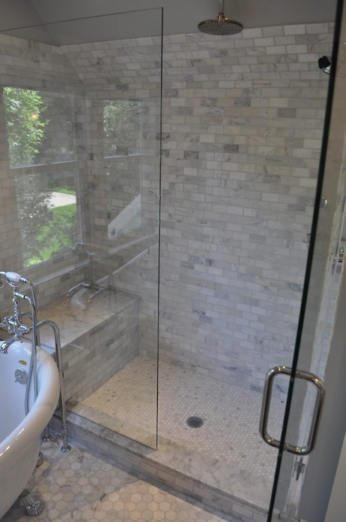 Stunning glass shower design with carrara marble subway for Tile shower surround