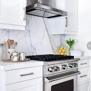 White kitchen cabinets with blue glass backsplash - Quartz Slab Backsplash Design Ideas