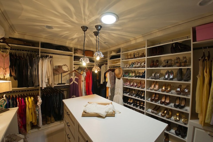 luxurious walk in closet with central closet island with drawers