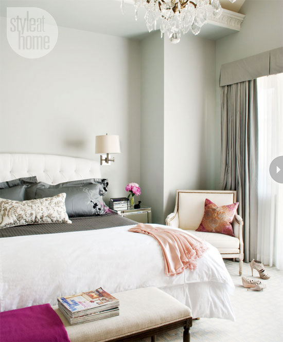 pretty bedroom with white diamond button tufted headboard and light