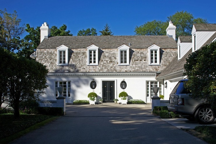 White stucco home traditional home exterior for Traditional home exterior