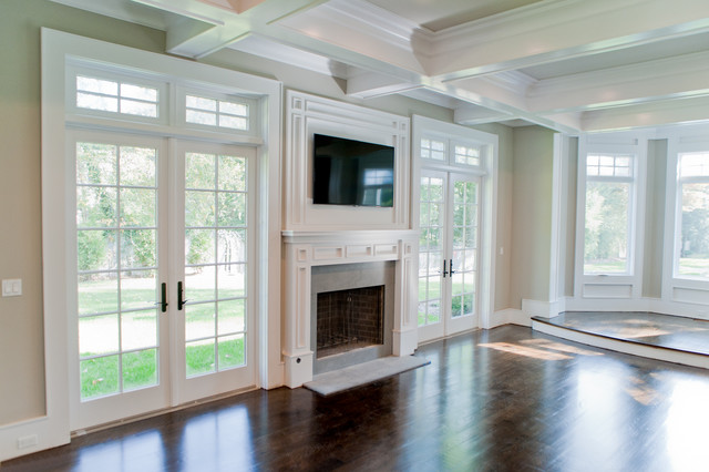 Incredible Living Room With Coffered Ceiling And Hardwood Floors