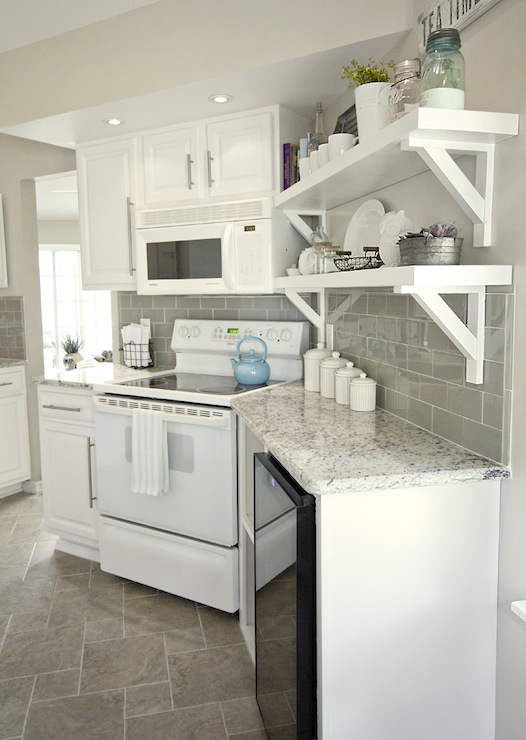Wonderful Kashmir White Granite Backsplash Ideas Part - 9: Stunning White And Gray Kitchen With White Kitchen Cabinets And Kashmir  White Granite Countertops With Loweu0027s Emser Tileu0027s Lucente In Morning Fog  Tile ...