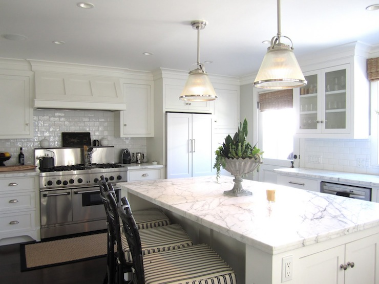 White kitchen cabinets with marble countertops cottage for Casual home kitchen island