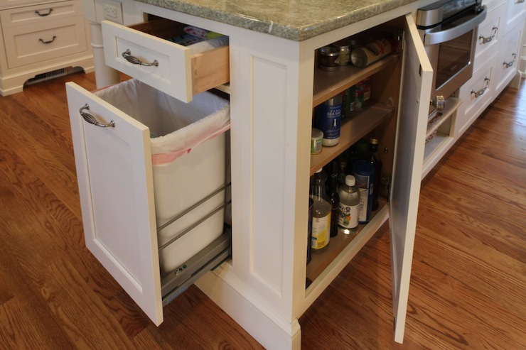 Kitchen island hidden garbage can transitional kitchen for Hidden kitchen storage ideas