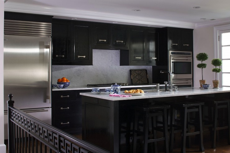Glossy black kitchen cabinets transitional kitchen for Images of black kitchen cabinets