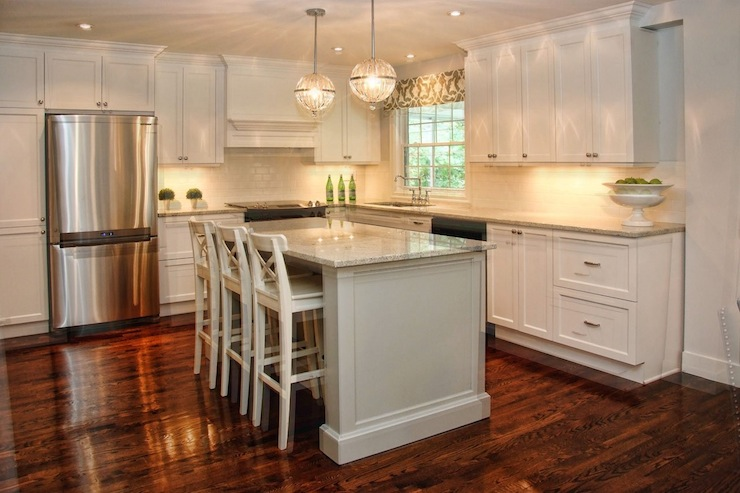 elegant l shaped kitchen with central eat in kitchen island and white