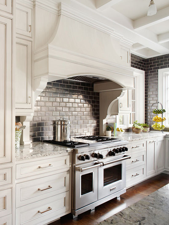 Fabulous Kitchen With Cream Cabinets Paired Granite Countertops And Black Subway Tile Backsplash