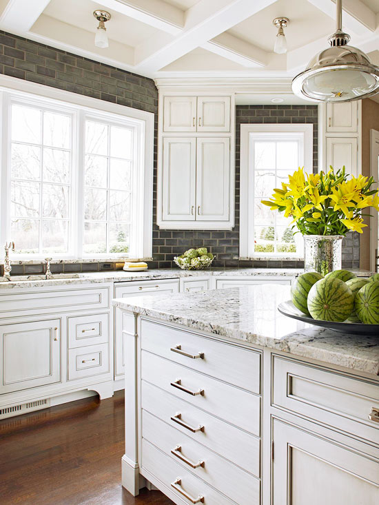 Off white kitchen cabinets traditional kitchen for Ceiling mounted kitchen cabinets
