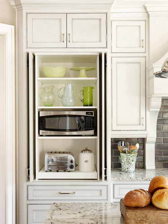 Hidden microwave cabinet transitional kitchen bhg for Hidden kitchen storage ideas
