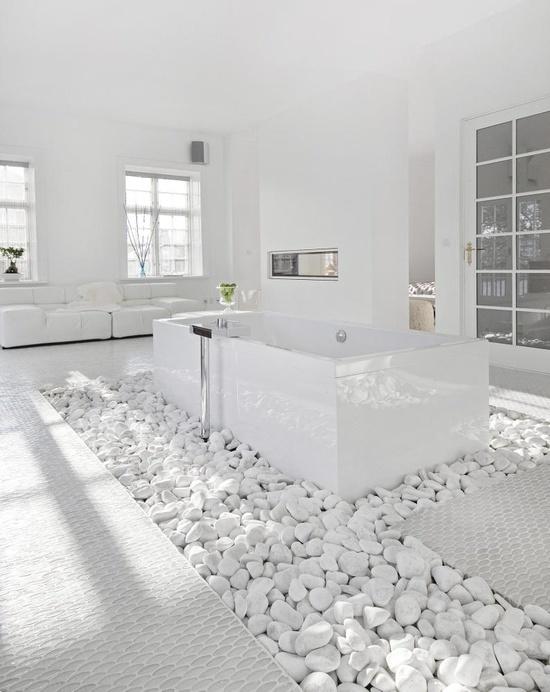 Modern White Bathroom Design With Stark White Walls And Gray Geometric Tile  Floor.