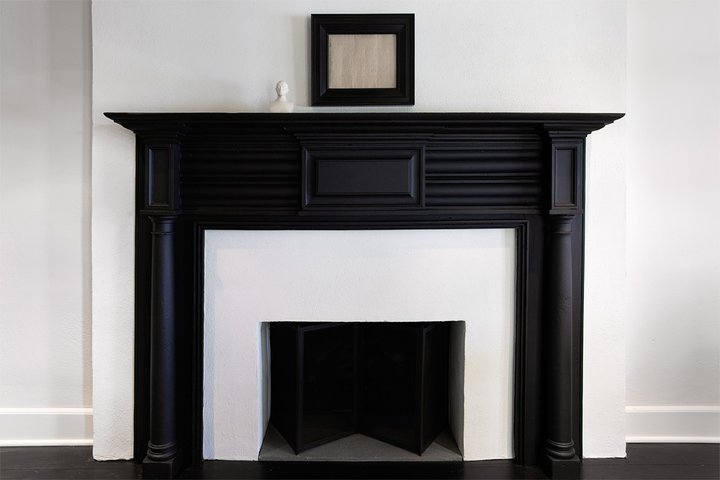 living room features black fireplace with millwork - Black Fireplace Mantels