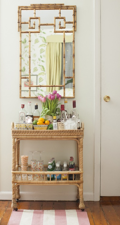 Lovely Vignette Of Light Green Walls Framing Gold Bamboo Mirror Over Serena And Lily South Seas Bar Cart Filled With Libations White Pink Striped