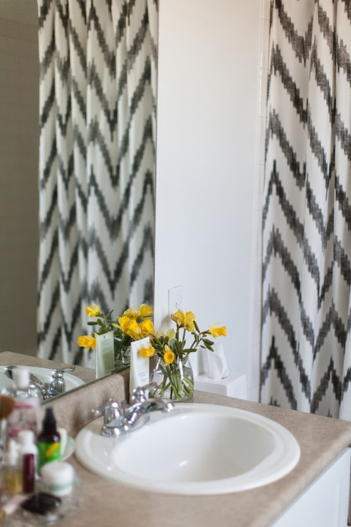 black white chevron shower curtain. Stunning bathroom with drop in tub and West Elm Chevron Shower Curtain  Leo Black White Panel Pair